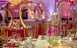 Room decorated for an indian wedding, rich gorgeous colors of gold and bright pink